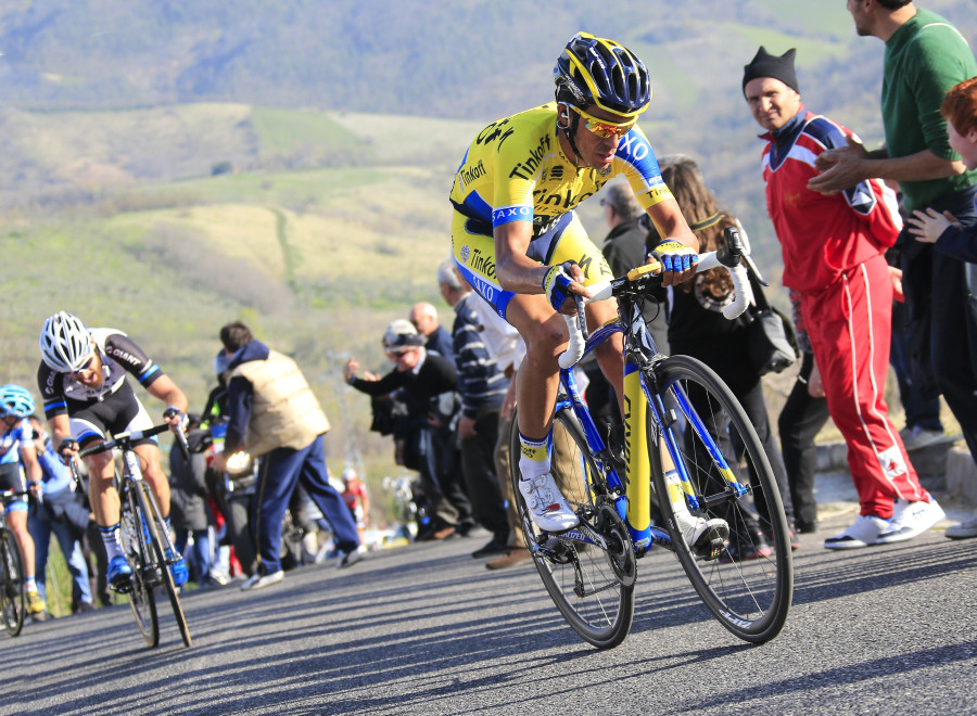 Contador catches then passes the front of the race on the 30% climb.