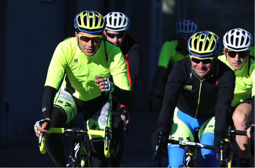 Rolling out on team issue bikes with team car following, Ivan Basso and Sergio Paulinho lead the way. A low intensity recovery ride for Sergio; who favored the new Fiandre Extreme Neoshell Jacket. Pietro Illariette to the right looking sharp!